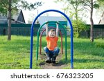 kid playing outdoors. boy on... | Shutterstock . vector #676323205