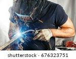 a strong man welder in a black... | Shutterstock . vector #676323751