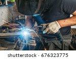 a strong man welder in a black... | Shutterstock . vector #676323775