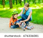 mom examines the wound of his... | Shutterstock . vector #676336081