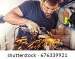 a young man welder in a black t ... | Shutterstock . vector #676339921