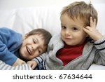 two brothers on sofa. | Shutterstock . vector #67634644
