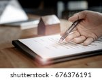 estate agent gives pen and... | Shutterstock . vector #676376191