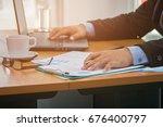 a businessman analyzing... | Shutterstock . vector #676400797