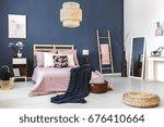 Stock photo big white mirror standing in the corner of cozy bedroom 676410664