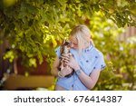 a small dog in the hands of a... | Shutterstock . vector #676414387