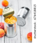 canned apricots on rustic...   Shutterstock . vector #676418815