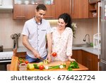 couple cooking in kitchen... | Shutterstock . vector #676422724