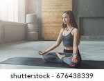 young woman in yoga class ... | Shutterstock . vector #676438339