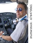 Small photo of GRAN CANARIA, CANARY ISLANDS - MAY 26, 2014: Copilot in the cockpit of a commercial airliner