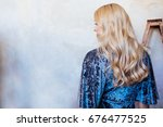 elegant blonde woman in the... | Shutterstock . vector #676477525