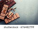 broken chocolate bar on dark... | Shutterstock . vector #676482799