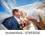 bride and groom under the veil | Shutterstock . vector #67651018