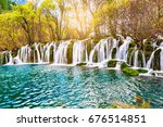 autumn view of the waterfall... | Shutterstock . vector #676514851