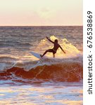 surfer surf in the ocean at... | Shutterstock . vector #676538869