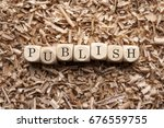 Small photo of Publish word in cube wood