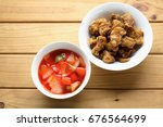 sweet and sour pork on wooden... | Shutterstock . vector #676564699