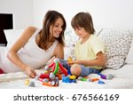 cute pregnant mother and child... | Shutterstock . vector #676566169