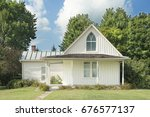 american gothic house | Shutterstock . vector #676577137