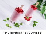 frozen fruit popsicle on a... | Shutterstock . vector #676604551