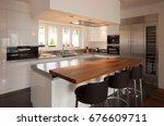 modern kitchen in luxury... | Shutterstock . vector #676609711