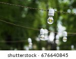 light bulbs garland outdoor.... | Shutterstock . vector #676640845