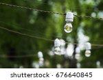 light bulbs garland outdoor.... | Shutterstock . vector #676640845