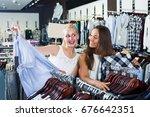 two cheerful girls shopping top ... | Shutterstock . vector #676642351