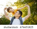 man holding boy on shoulders... | Shutterstock . vector #676651825