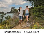 two women walking through nature | Shutterstock . vector #676667575
