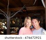 man and woman smiling in lodge...   Shutterstock . vector #676672921