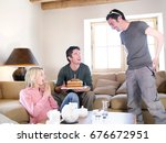 friends laughing with cake in... | Shutterstock . vector #676672951