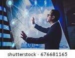 smart businessman using the... | Shutterstock . vector #676681165