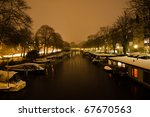 Snowy Amsterdam At Night - stock photo