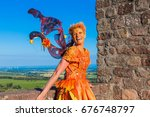 laughing fairy in orange dress | Shutterstock . vector #676748797