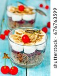 Small photo of Marshmallow chocolate biscuit cherry trifle, dessert in glass