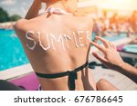 summer concept. man writing the ... | Shutterstock . vector #676786645