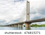 cable bridge on the river.... | Shutterstock . vector #676815271