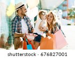 happy family with shopping bags ... | Shutterstock . vector #676827001