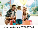 happy family with shopping bags ... | Shutterstock . vector #676827064