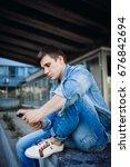brunette boy in jeans jacket... | Shutterstock . vector #676842694