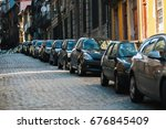 cars parked along the streets... | Shutterstock . vector #676845409