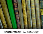 Small photo of Background with lot old paper books in cover on shelf. Variety of roots printed books. Education and intelligence are well-read people. Old book from short stories and novels. Passing of time read.