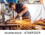 a young man welder in a black t ... | Shutterstock . vector #676892029