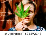 beautiful girl with a cannabis... | Shutterstock . vector #676892149