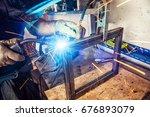 a young man welder wearing a... | Shutterstock . vector #676893079