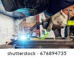close up a young man welder... | Shutterstock . vector #676894735