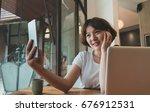 young asian woman using... | Shutterstock . vector #676912531