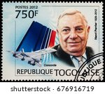"Small photo of Moscow, Russia - July 14, 2017: A stamp printed in Togo shows Director of the Concord Project Henri Perrier and airliner Concorde, series ""Concorde - Henri Perrier, 1929-2012"", circa 2012"