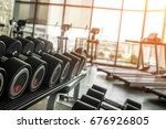 barbells in gym for fitness... | Shutterstock . vector #676926805